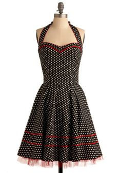 Ooh. After the halter made out of cherry fabric - I can make this. Same basic pattern with a little tulle trim!