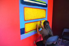 """Rhett Lynch works on """"Hozho,"""" a guest room at Nativo Lodge, in Albuquerque. Click for more info! #ArtisticNM"""
