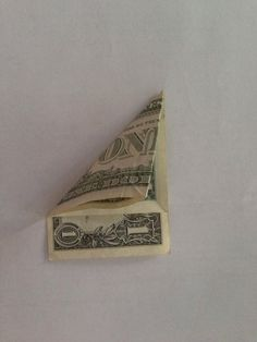 For best results, use a crisp (new) bill which will hold the folds better. Fold diagonally, doesn't matter which side. Fold diagonally again in other direction. Origami Star Paper, Origami Ball, Money Origami, Origami Tooth, Origami Boxes, Oragami, Diy Paper, Dollar Heart Origami, Easy Dollar Bill Origami