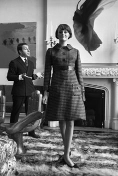 Arnold Scaasi with a model wearing his design in 1965.