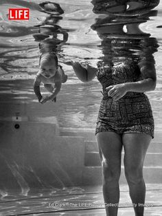 9-week-old Julie Sheldon, cruises underwater next to her grandmother, Mrs. Jen Loven, a children's swimming instructor in 1954 Los Angeles.