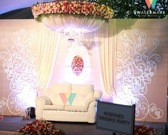 bride and groom seat, floral mushroom ceiling, chandelier, wall backdrop, stage decor