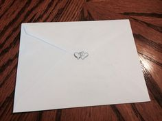 Wedding invitation envelope with two silver hearts sticker