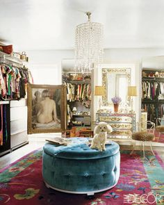 For fashion designer Nanette Lepore's Manhattan townhouse, decorator Jonathan Adler devised a colorful and shimmering dressing room that nods to old-time Hollywood glamour. Lepore's toy poodle, Bunny, sits on a tufted, velvet-covered ottoman, and the rug is Chinese Art Deco. A mirrored chest of drawers by Raymond Lepore and a crystal chandelier add touches of sparkle.
