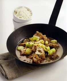 """Pan fried pork with leek or """"Prasotigania"""" as it is called in Greek, is an easy to prepare, delicious dish that is usually served as a meze, accompanying ouzo or wine Mizithra Cheese, Moussaka, Fried Pork, Greek Salad, Tzatziki, Greek Recipes, Coriander, Tasty Dishes, Finger Foods"""
