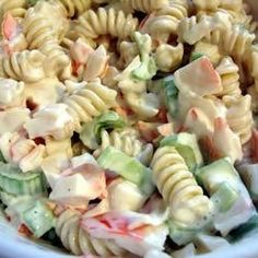 Rainbow pasta dotted with green peas, crunchy bits of celery, and imitation crabmeat is wrapped in a creamy dressing with a touch of sweetness.
