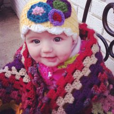crocheted hat with circles by Sharon.. blanket continuous granny square by Nan!
