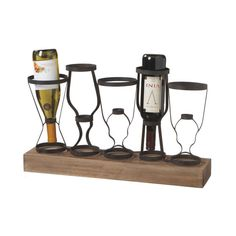 Tabletop wine rack with a wood base and metal bottle holders. Product: Wine rackConstruction Material: Metal and woodColor: Black and naturalFeatures: Holds five wine bottlesDimensions: H x W x DNote: Accents pictured are not included Rustic Wine Racks, Rustic Industrial Decor, Wine Glass Rack, Wine Bottle Holders, Wine Bottles, Construction, Vintage Farmhouse, Farmhouse Style, Wine Storage