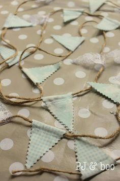 we can do this bunting with the little squares @Ellen Page Winser and use string!!!