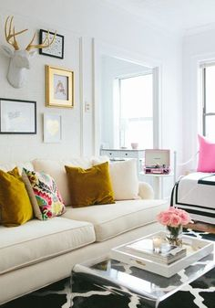 This is exactly how I envisioned my living room. White couch, lucite coffee table. The rug would be grey instead of black. The pops of color would be coral &/or soft pink for summer & switched to jewel tones in the winter. & my floral print Crossley turntable displayed and open.
