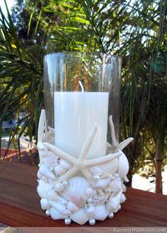 "Materials glass candleholder, 8""x4"" white pillar candle, 6""x 3¾"" 4 starfish, 4"" wide various seashells (we used approximately 60-75 shells) 13 white pearls, 8mm 14-18 white pearls, 6mm iridescent g..."