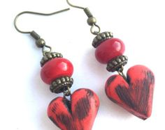 Red and antique bronze heart earrings with red glass lampwork rondelles and polymer clay heart beads