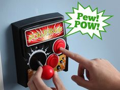 The Power-Up Arcade Light Witch Plate is an arcade joystick shaped light switch that fits over your existing light switch. Flip the joystick to turn the lights on and off. Press the buttons for authentic arcade sound effects.
