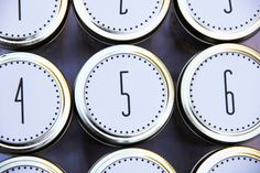 Maybe decorate a metal cookie sheet and get these reusable metal spice canisters and put magnetic tape on the bottom of each one for a DIY advent calender. Tops of lids could have something more decorative and interesting.  Google Image Result for http://www.studiodiy.com/wordpress/wp-content/uploads/2011/11/diy-mason-jar-advent-calendar.jpg