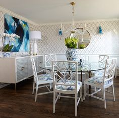 Round glass tabletop, blue patterned chairs and wall art | Hallie Henley