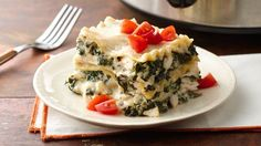 Creamy, cheesy Alfredo sauce layered with chicken and spinach makes this easy slow-cooker lasagna an elegant alternative to the classic Italian dish.