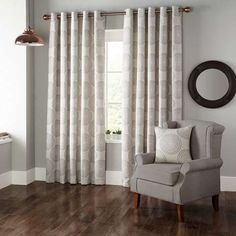 Add a touch of style to your decor with our striking linen look ready made curtains, featuring an eyelet header and fully lined for added warmth.