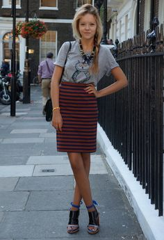 Tuck a novelty t-shirt into a striped pencil skirt. Ornate jewelry and wild heels make the look feel a bit artsy.
