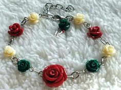 Help us spread awareness and give the gift of Health for the Holidays! This bracelet is adjustable, measuring 6.75-8.5. It features a large red rose at the center, surrounded by smaller red, green, and cream colored roses. All proceeds will benefit Get America Covered.