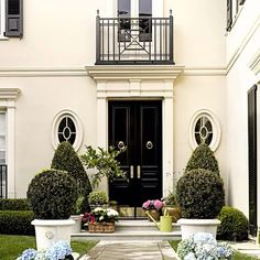 Whenever you pass by a house, what really stands out and catches your eye is the home's front door. You can create big time curb appeal with huge double doors and nice shiny hardware. Exterior Design, Interior And Exterior, Interior Garden, Exterior Doors, Monochromatic Room, Beverly Hills Houses, Front Entrances, Architecture Details, Classical Architecture