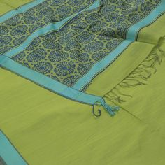 """The """"#Green"""" #handwoven #Organic #Cotton #Sari from Ethicus is set off by a blue border on either side. Attractive blue floral motifs adorn the green pallu. The border is repeated on the grey blouse that completes the sari."""