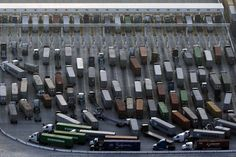 Trucks wait in line at the Port of Los Angeles in February. Congestion at the...