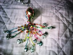 Colorful 'papier mâché' and silver Keychain COP$ 8.000=