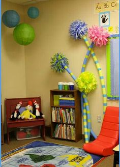 I know this is a classroom but the lorax trees would be cute for a kids party its just a pool noodle, a pom and some tape or something for the stripes Classroom Setting, Classroom Design, School Classroom, Classroom Themes, Classroom Organization, Book Corner Classroom, Preschool Reading Corner, Library Corner, Kindergarten Classroom