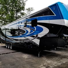This gorgeous paint scheme looks amazing rain or shine! Build your own customizing the inside and out! Luxury Fifth Wheel, Fifth Wheel Toy Haulers, Paint Schemes, Build Your Own, Ann, Wheels, Toys, Building, Amazing