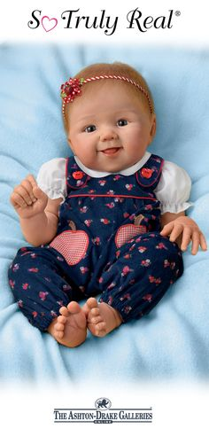 The Apple Dumpling So Truly Real Baby Doll by Master Doll Artist Sandy Faber is poseable and weighted to feel so real in your arms, and she's hand-painted to enhance her lifelike features. Dressed in a white and blue apple-themed outfit, she's sure to be the apple of your eye! Shop Now!