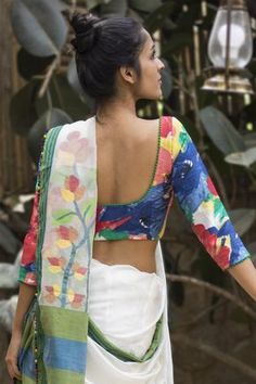 We never tire of florals! Cool painterly florals on a classic U neck blouse with…