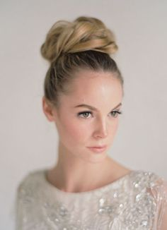 Sleek and chic updo wedding hairstyle; Featured Photographer: Bryce Covey Photography