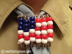 Using safety pins, pony beads and a PVC Pipe you can create this awesome American Flag Cub Scout Neckerchief Slide!