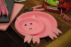 A pink dinner plate and a pink dessert plate make the body of this adorable pig! Use construction paper or...