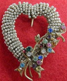 Miriam Haskell heart shaped pin with seed pearls and multi colored stones