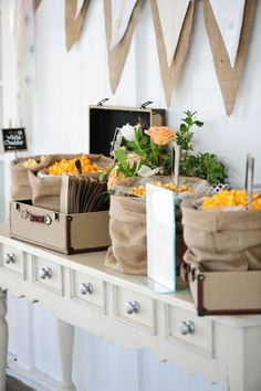 A Beautiful Rustic Chic Popcorn Bar. Use a long, narrow table for a display, and burlap bags for treat bags. Follow more of this trend at http://www.arizonaweddings.com/