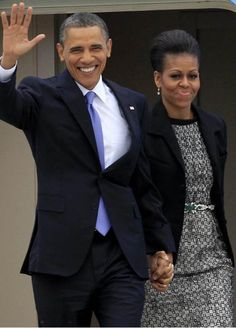 #44th #President #POTUS Of The United States  Of America #CommanderInChief #BarackObama waves as he and his wife, #FirstLady #FLOTUS Of The United States  Of America #MichelleObama leave Air Force One at the Dublin Airport on May 23, 2011. The first lady wears a black and white openwork lace sheath dress by Peter Som.