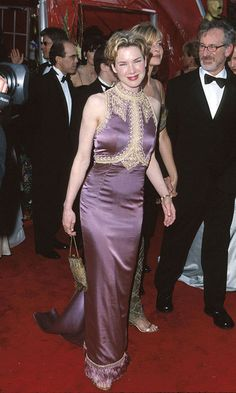 The actress donned a purple high-neck gown, which featured tassel detailing at the hemline, for the 1999 Academy Awards.