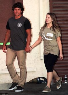 Young love: Bindi Irwin was hand in hand with boyfriend Chandler Powell on Saturday aftern...