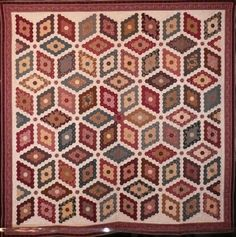 Sue Garman: A Hex on Blog Time Sneaking Up on Me! The quilt below was part of the French Legendary Quilts exhibit at the International Quilters Association (IQA) show in Houston last year. These quilts are totally hand-made (no machine work at all!) and are replicas of antique quilts. This quilt, Mosaic quilt, was made by Isabelle Etienne-Bugnot of Soisy-sur-Seine, France. It is based on a circa 1840 quilt in the DAR Museum in Washington, D.C.