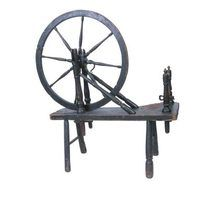 Old-fashioned spinning wheel.