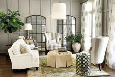 Hanging a mirror or a pretty collage of smaller mirrors across from a window amplifies the natural light and gives the illusion of another window, creating a lighter, brighter room. And if you don't have the natural light to bounce around, you can place a mirror near a lamp or wall sconce to create a similar effect. This is a great trick to try in a bedroom where the shades are often drawn.