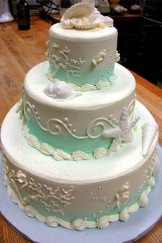 Three tier white and green beach wedding cake
