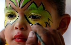 A girl has makeup applied during carnival celebrations in Galapa, Colombia, Sunday March 6, 2011.