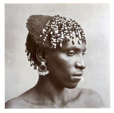 Africa   A Zulu girl with her hair strung with beads.  South Africa.  ca. late nineteenth century   ©J E Middlebrook (attr.)