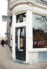 IDEE: Mooie uithangborden voor de bedrijven in de straat.  Inspiratie:De 9 Straatjes in Amsterdam | for endulging in food & shopping