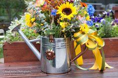 watering can flower arrangements