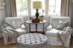 Round ottoman between chairs