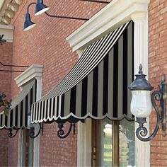 I appreciate this splendid farmhouse awning Front Door Overhang, Awning Over Door, House Awnings, Window Awnings, Metal Awnings For Windows, Window Shutters Exterior, Store Front Windows, Aluminum Awnings, Fabric Awning