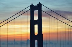 The Golden Gate Bridge at Sunrise from Marin Headlands overlooking the San Francisco Financial District